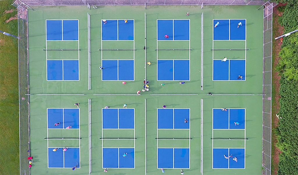 Aerial view of eight pickleball courts
