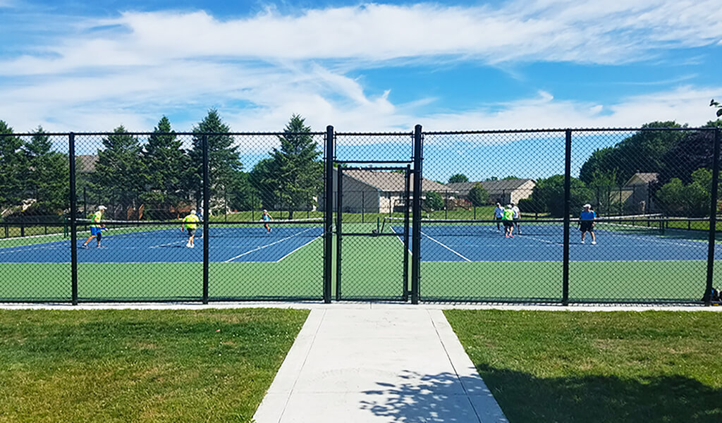 fence entrance to tennis/pickle ball courts
