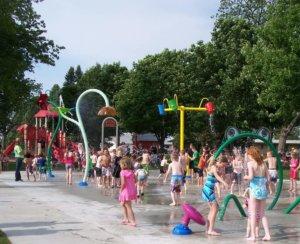 dozens of children playing in splash pad
