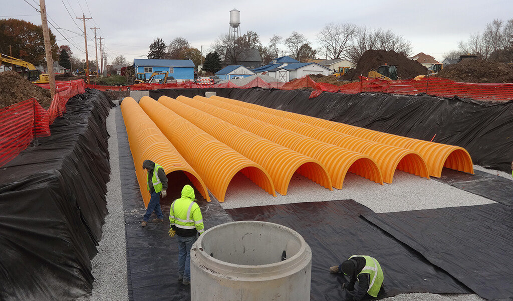 orange dome piping laid in detention basin