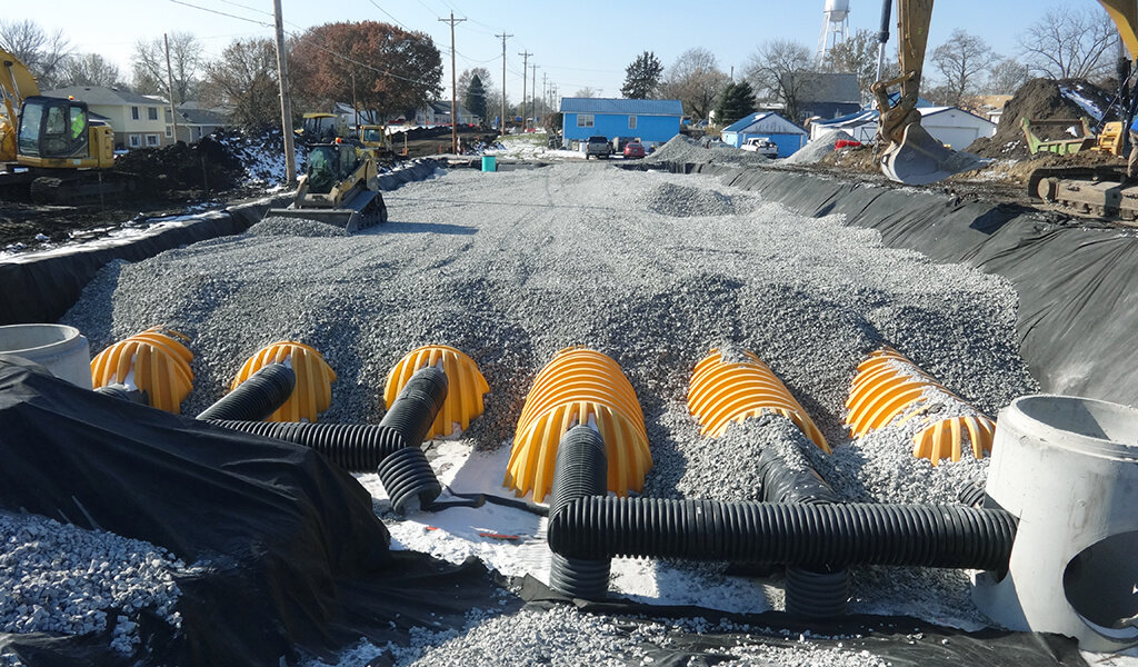 orange corrugated pipes used in detention basin