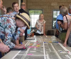 group of people gathered around a map