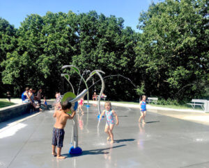 kinds running in splash park waters