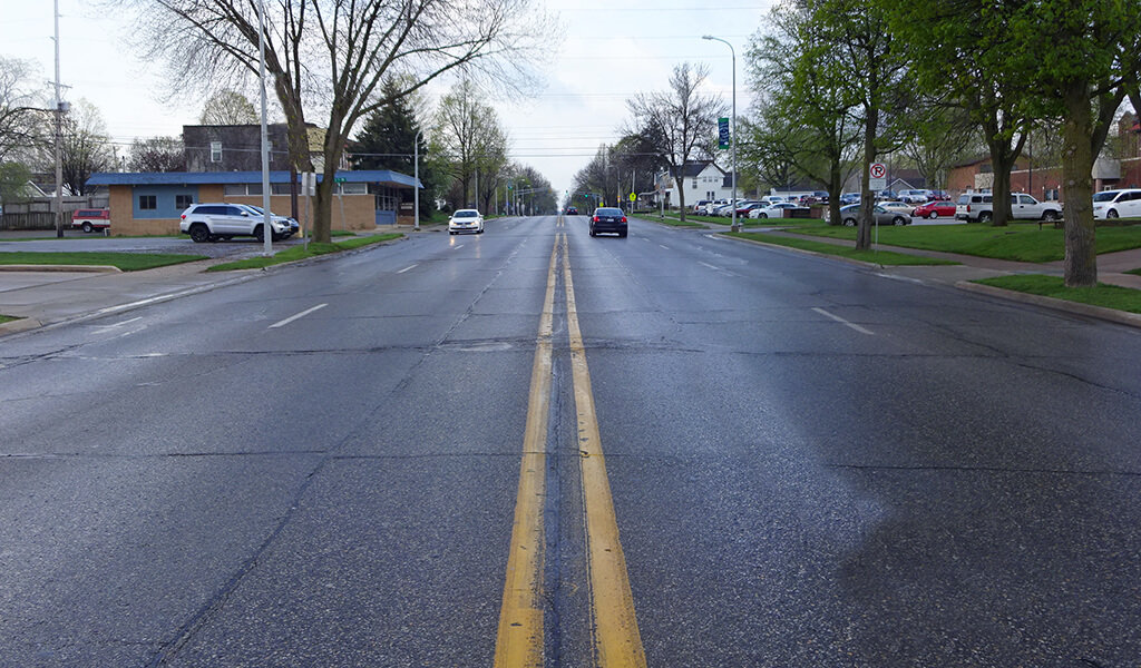 view from middle of the street with double yellow line