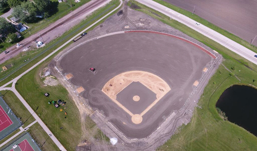 aerial view of dirt baseball diamond under construction