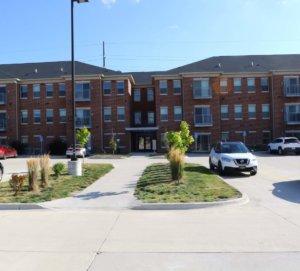 large brick apartment building front entrance