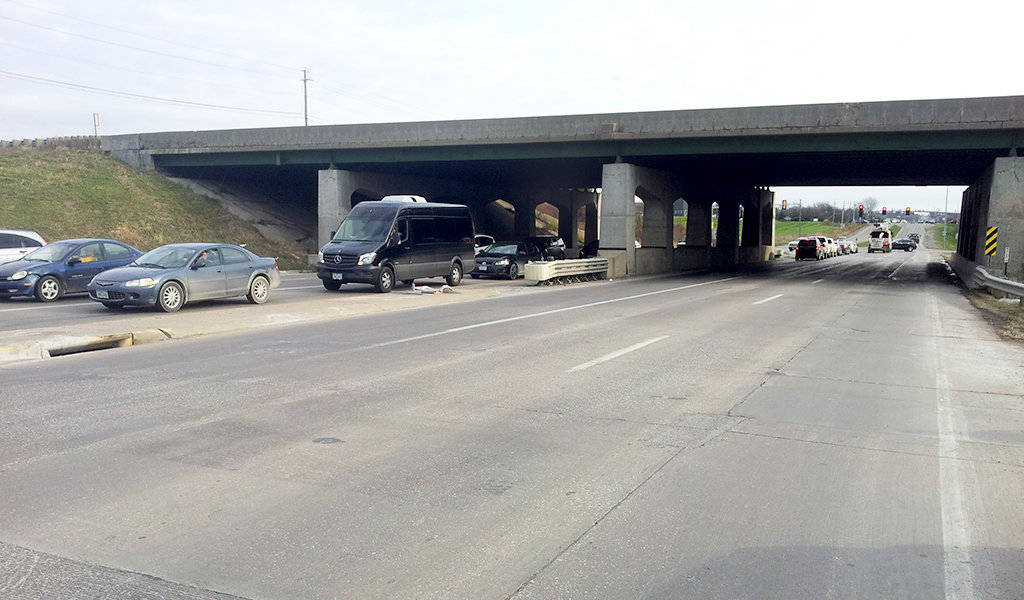 cars backed up under overpass due to traffic