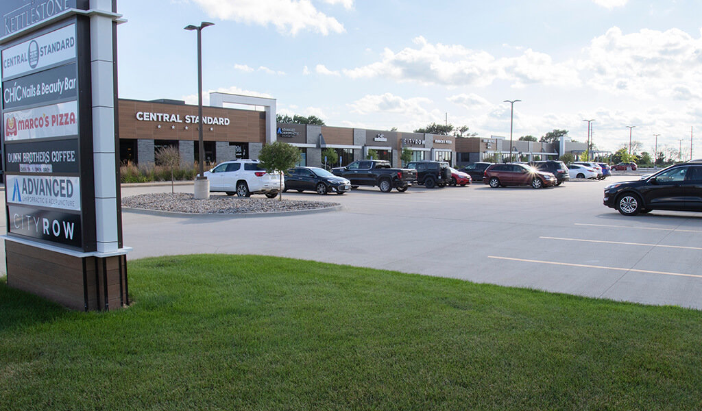 Businesses in a row and expansive parking