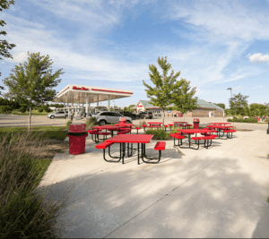 red picnic tables outside kwik trip