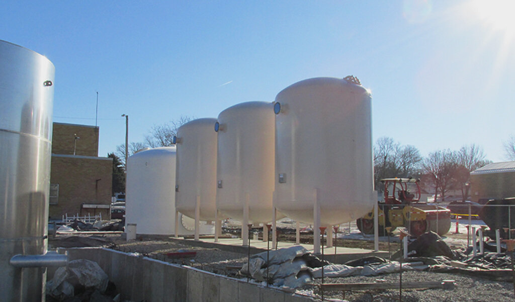 three large white tanks
