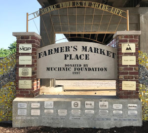 large brick and cement sign for farmers market