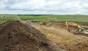 Large construction equipment moves dirt