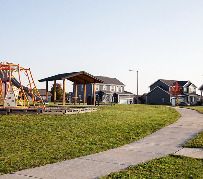 playground along a pathway towards residential houses