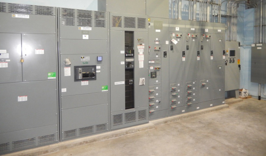 grey wall of electrical pannels