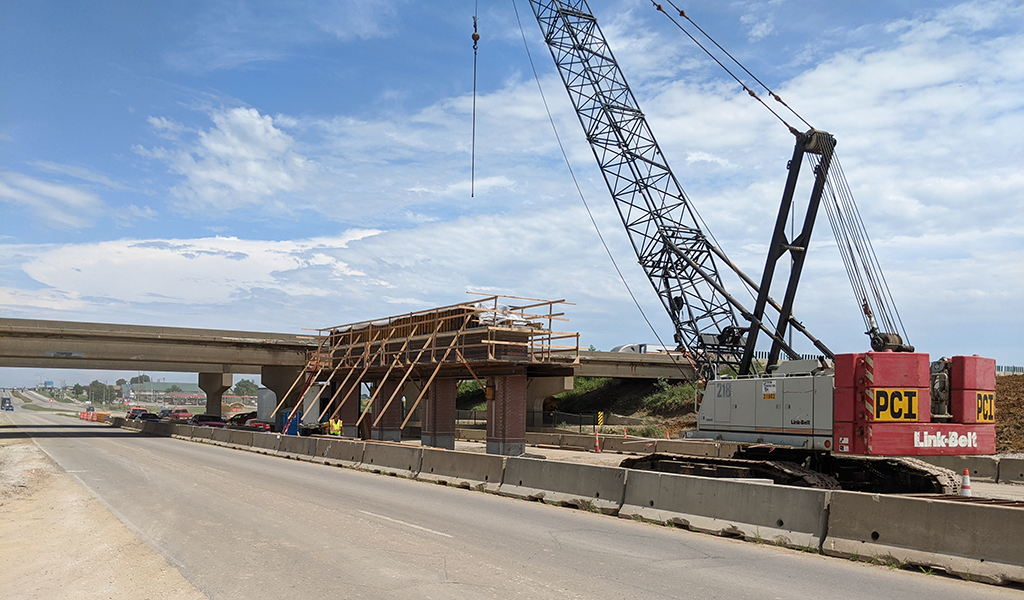 crane building interstate overpass