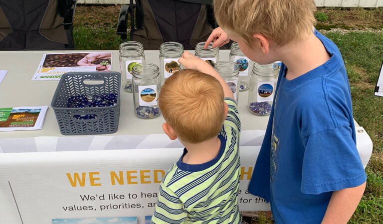two little boys participating in mason jar activity