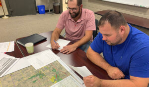 two men looking at a planning map