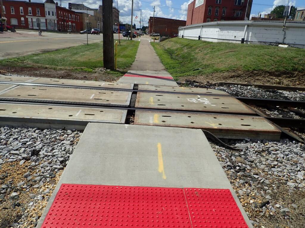 ADA compliant sidewalks near railroad tracks
