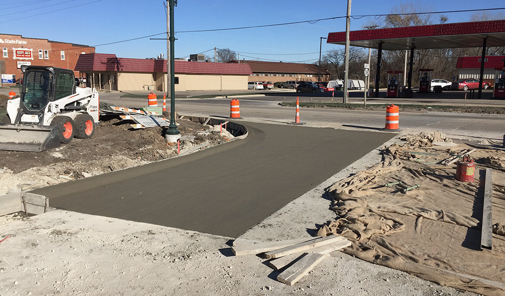 Freshly poured cement at recently completed intersect on E S street.