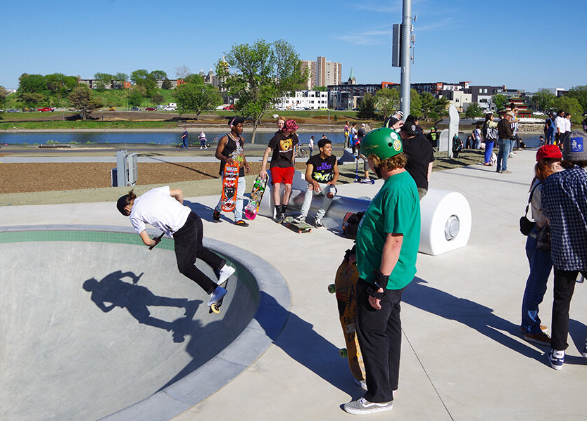 """Skateboarders wait their turn to """"drop-in"""" on one of the skateparks bowl features."""