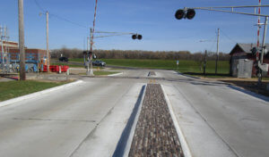 railway crossing with paved median