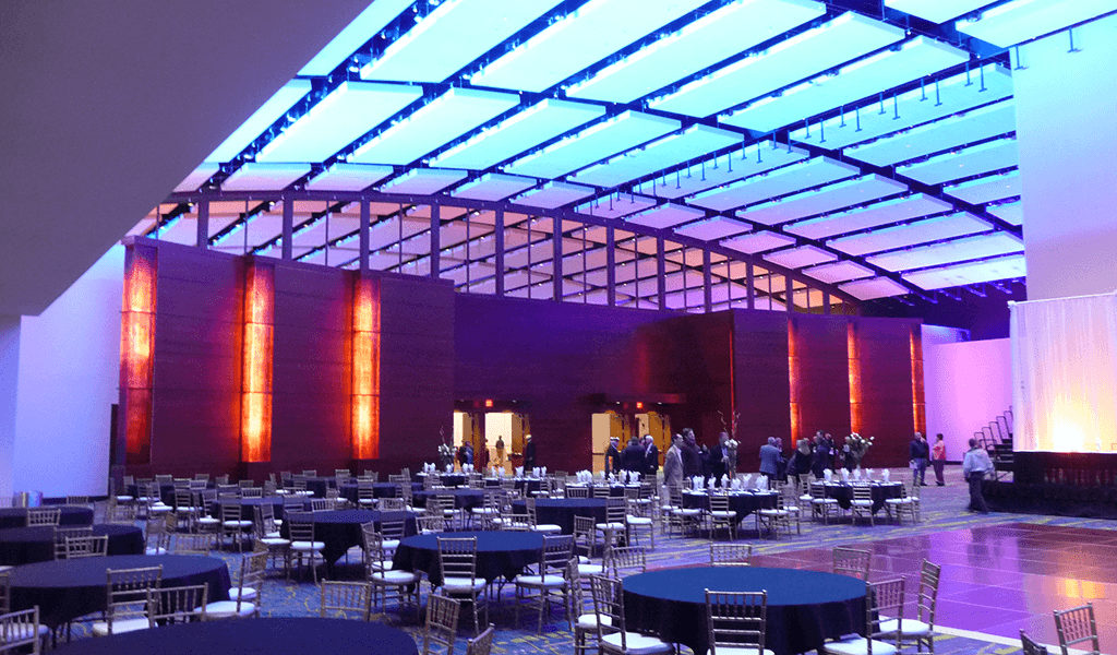 ballroom lit up with blue and purple lights