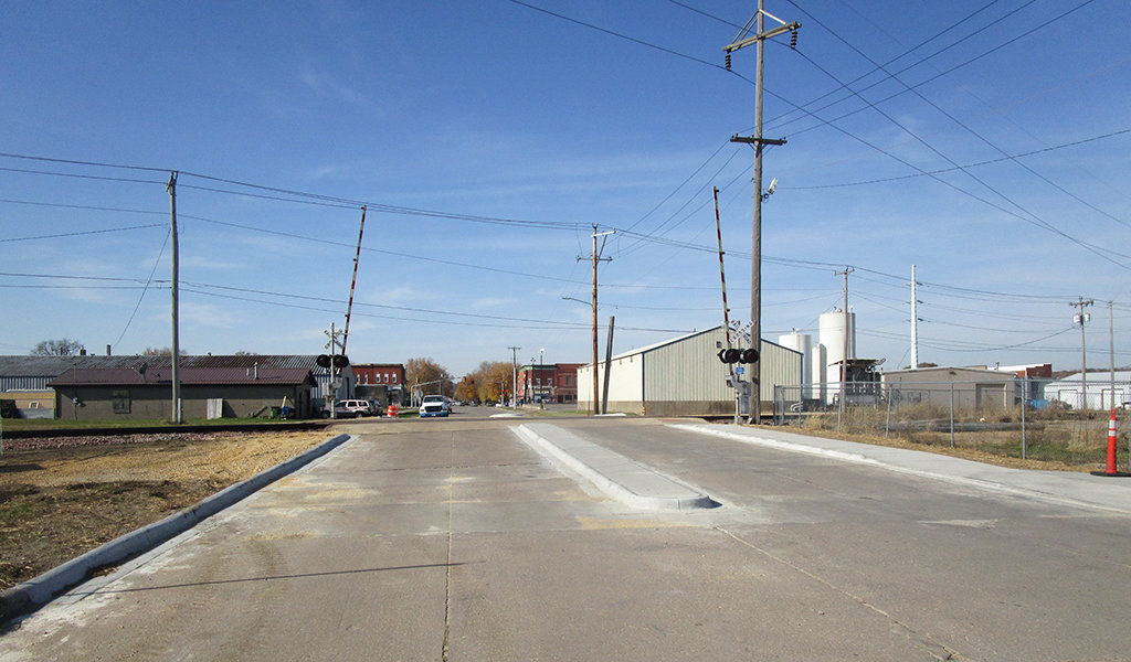 new concrete median leading up to railroad crossing