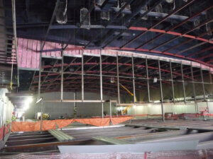 mid-construction metal beams exposed in ballroom
