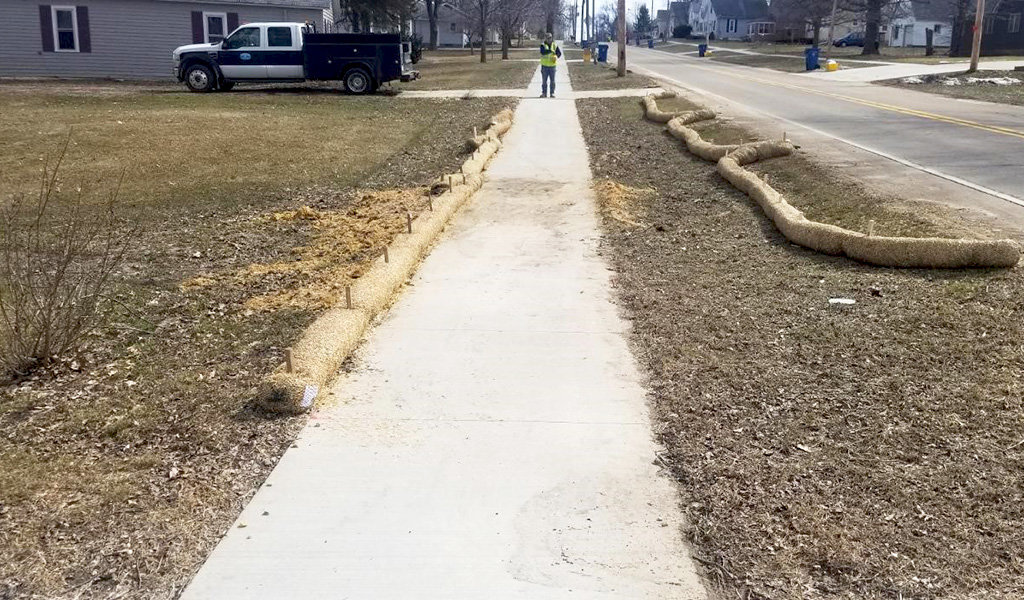 construction of new ADA compliant sidewalk surrounded by dirt