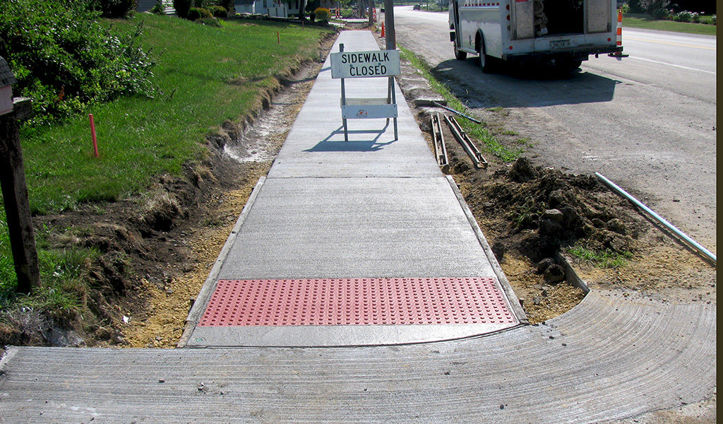 new ADA compliant sidewalk with red domes by street