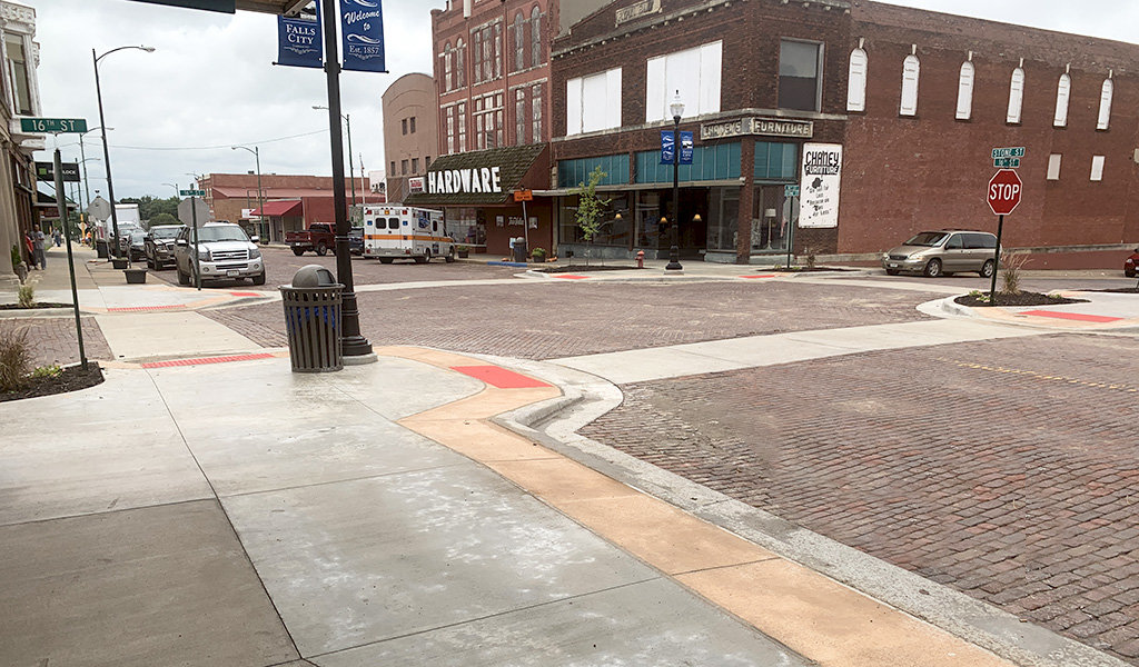 Stone street intersection with ADA compliant ramps.