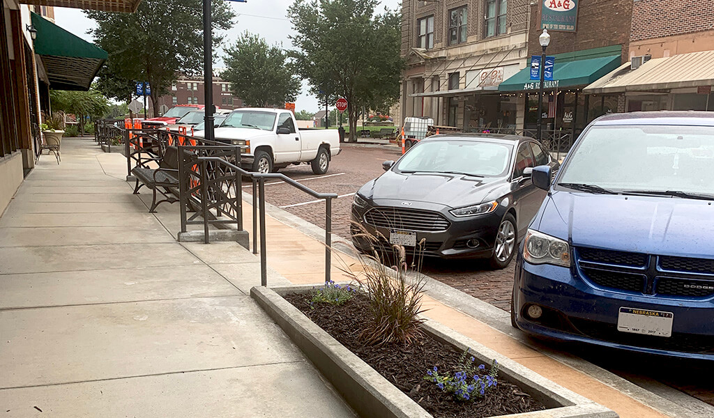 New sidewalks and decorative railings lining Stone street in Falls City, NE.