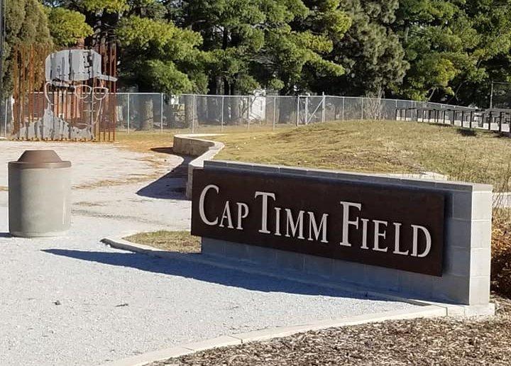 entrance to cap timm field showcasing cap timm memorial