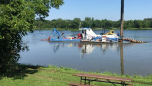 Primary hydraulic dredge boat on the main lake.