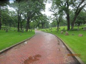 brick road running through a historic cemetery