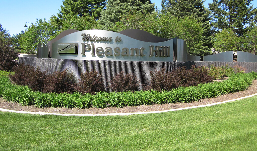 Branded gateway installation for the city of Pleasant Hill, Iowa.