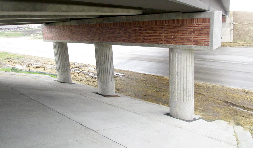 brick and concrete columns supporting a bridge