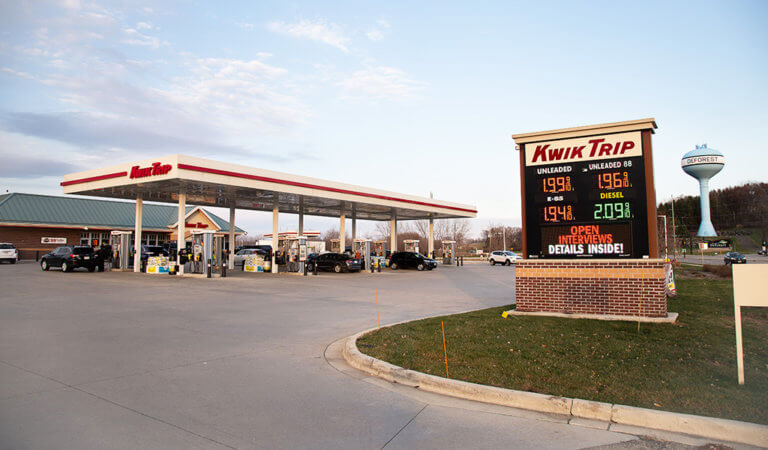 fuel prices are displayed on sign as vehicles enter and exit recently complete kwik trip convenience store