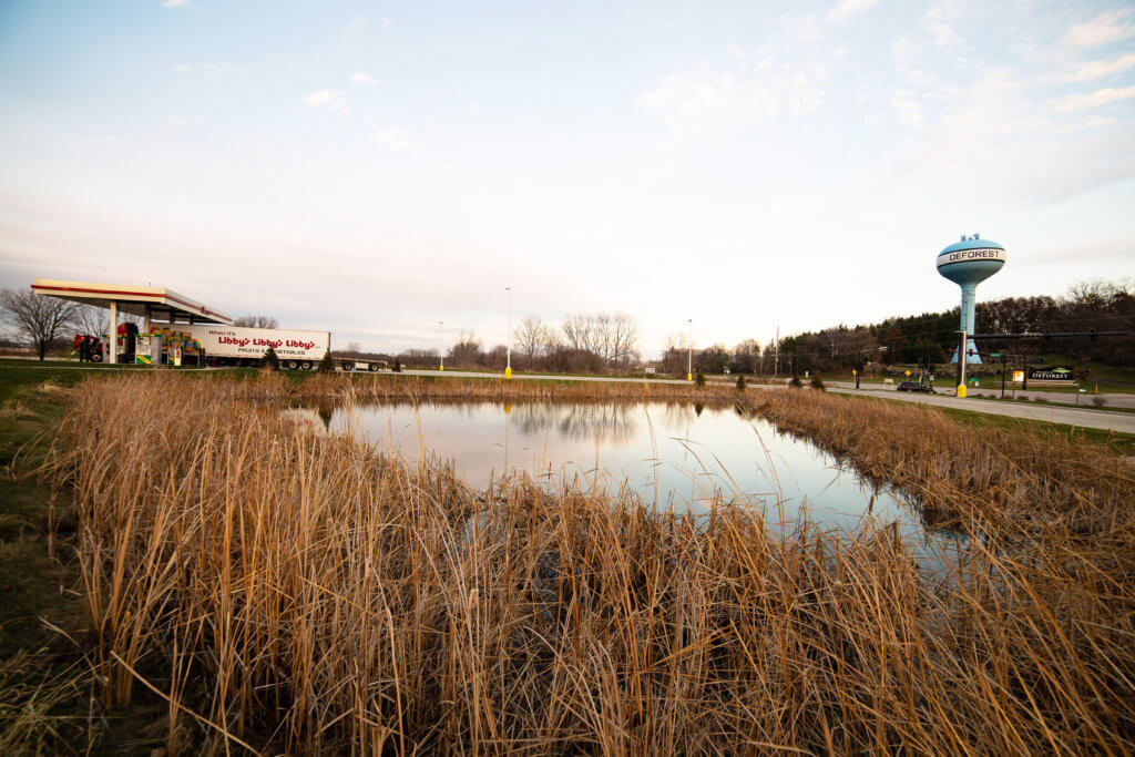 bio-retention basin enhances stormwater mitigation satisfy local requirements