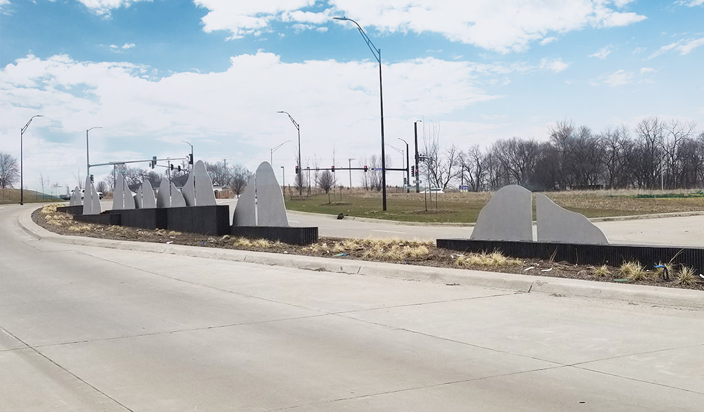 modern sculptures divide rebrand entry point roadway into Pleasant Hill Iowa