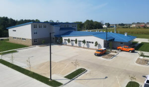 aerial view of recently complete contemporary iDOT facility and parking lot in Fairfield, IA