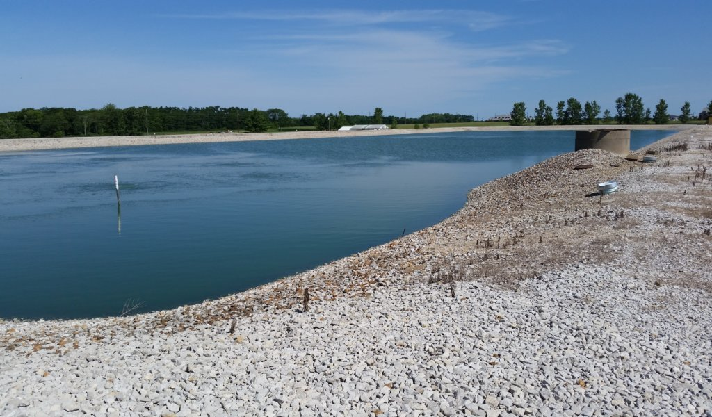 waterside view of lagoon and gravel shores