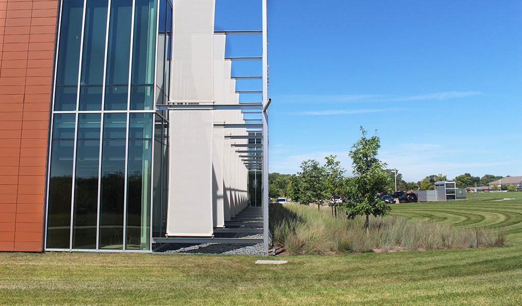 perforated sunscreen block sunlight from exterior glass wall of delta dental expansion