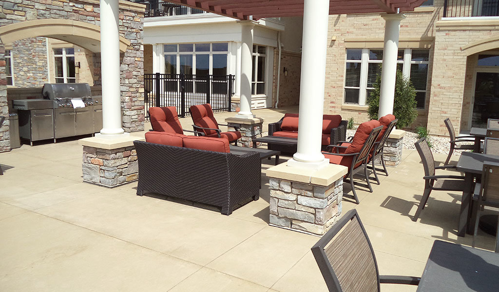 Community area provides shaded seating for residents of recently developed Pleasant View apartments in Madison, WI.