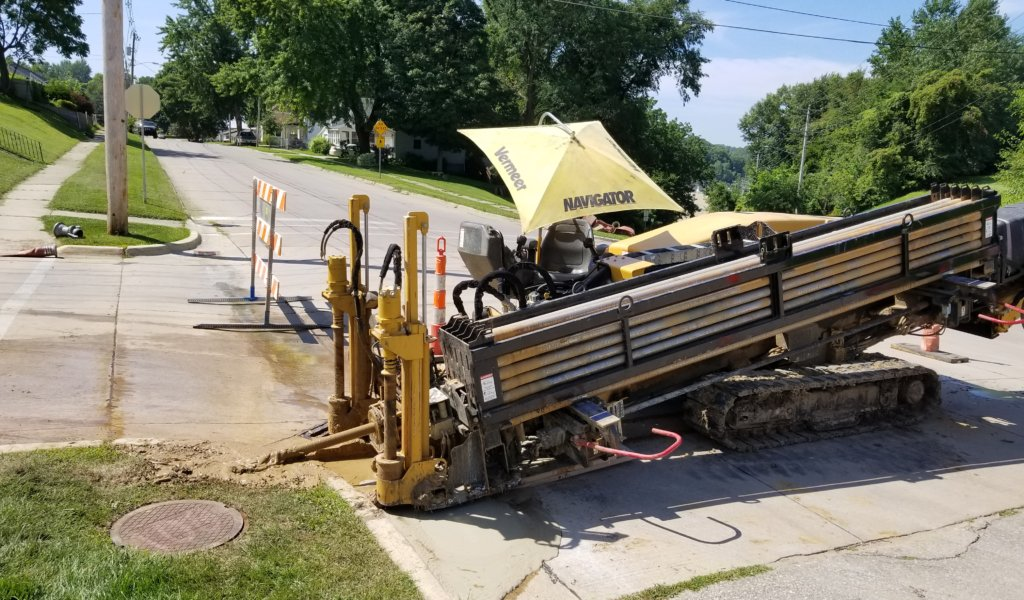 large machine used to bore holes and make way for pipe