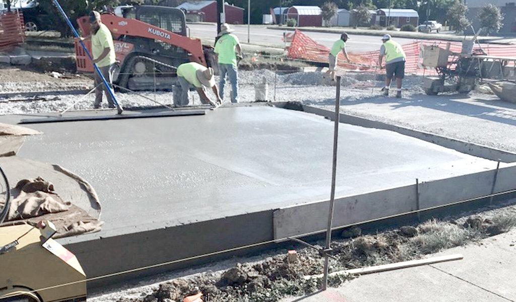 construction crew finishing pavement