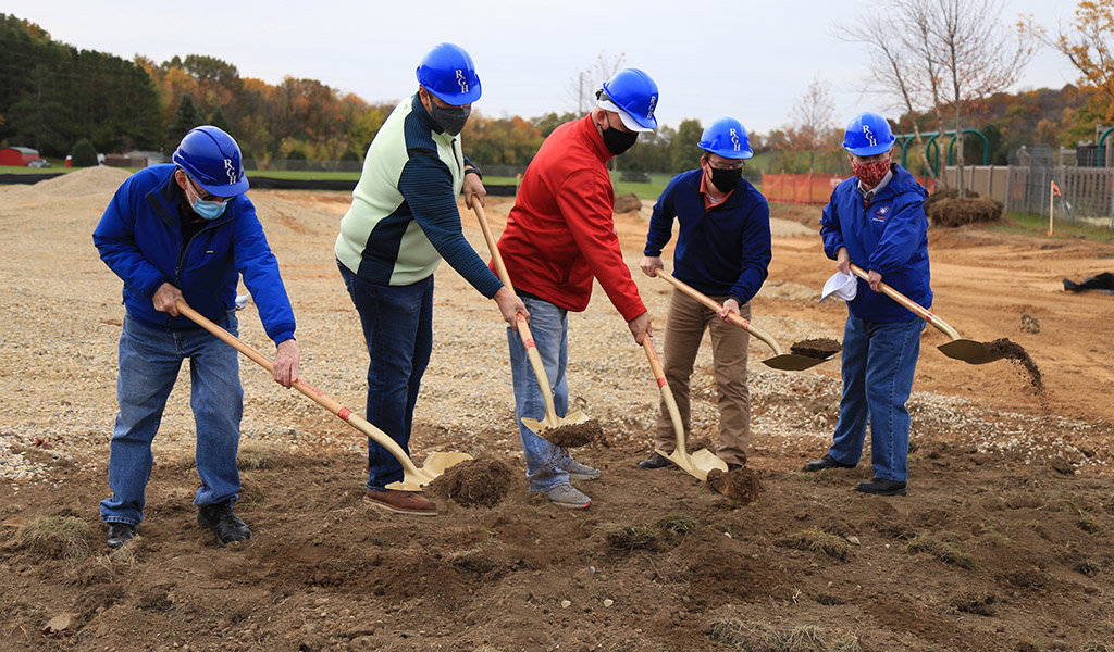 dane county miracle league organizers and volunteers shovel dirt during ceremonial groundbreaking