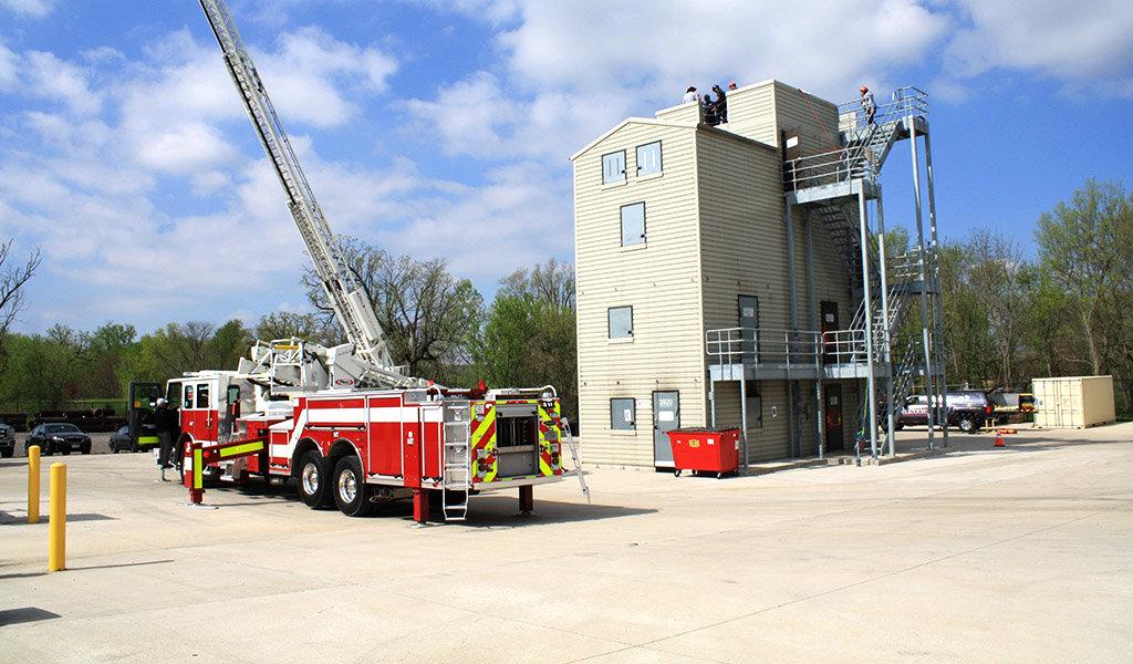 firetruck next to fire training tower