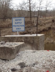 Water supply protection area sign next to river