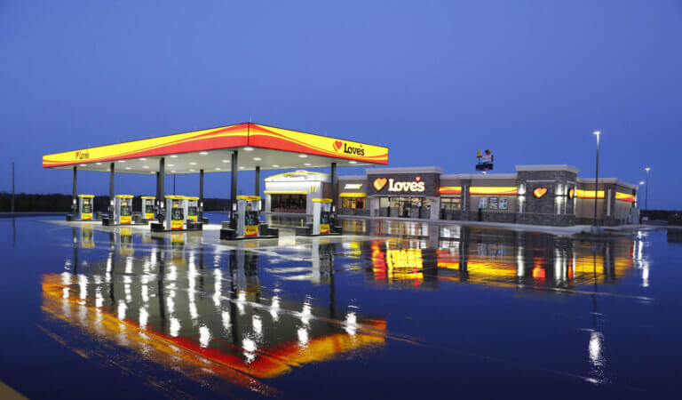 Photo of a Loves truck stop at night on a rainy day